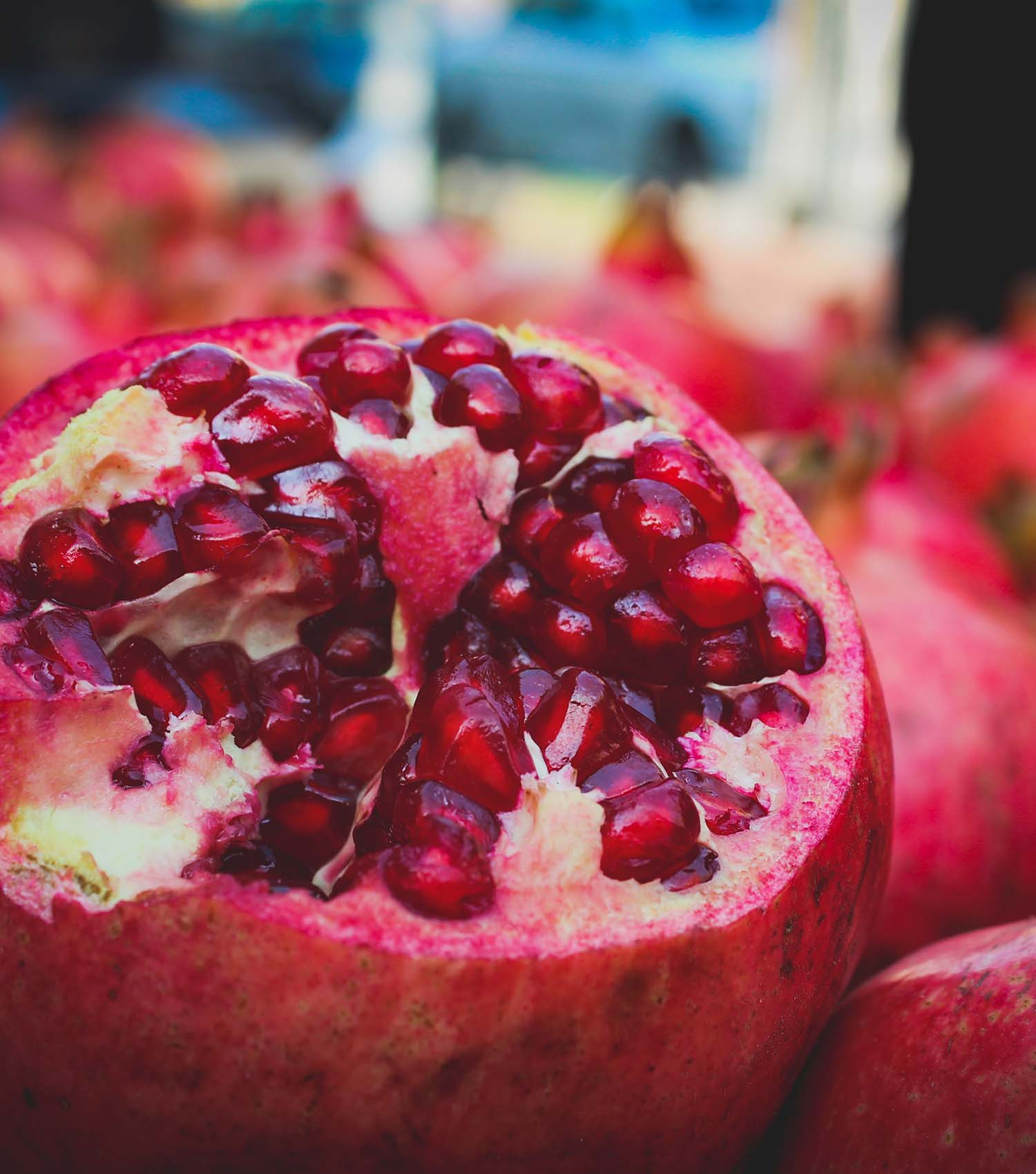 Cut pomegranates with many seeds as symbol of fertility and life