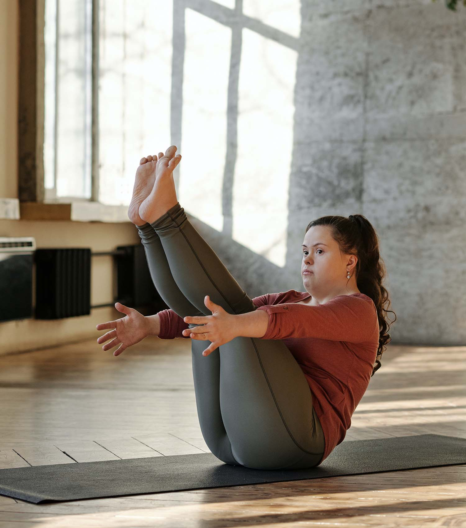 Woman with Down Syndrome doing yoga